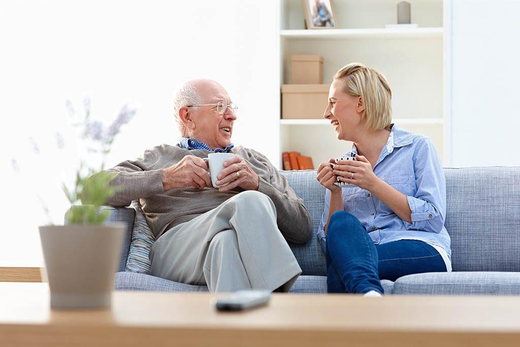 Older men talking to woman